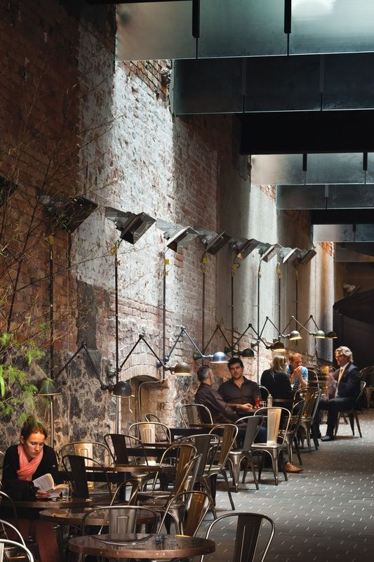 "The Imperial Buildings | Architecture Now ""Vintage Jieldé lamps are affixed to the wall in the laneway."""
