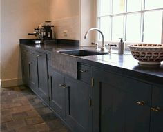Dark sone counter top integrating the window sill
