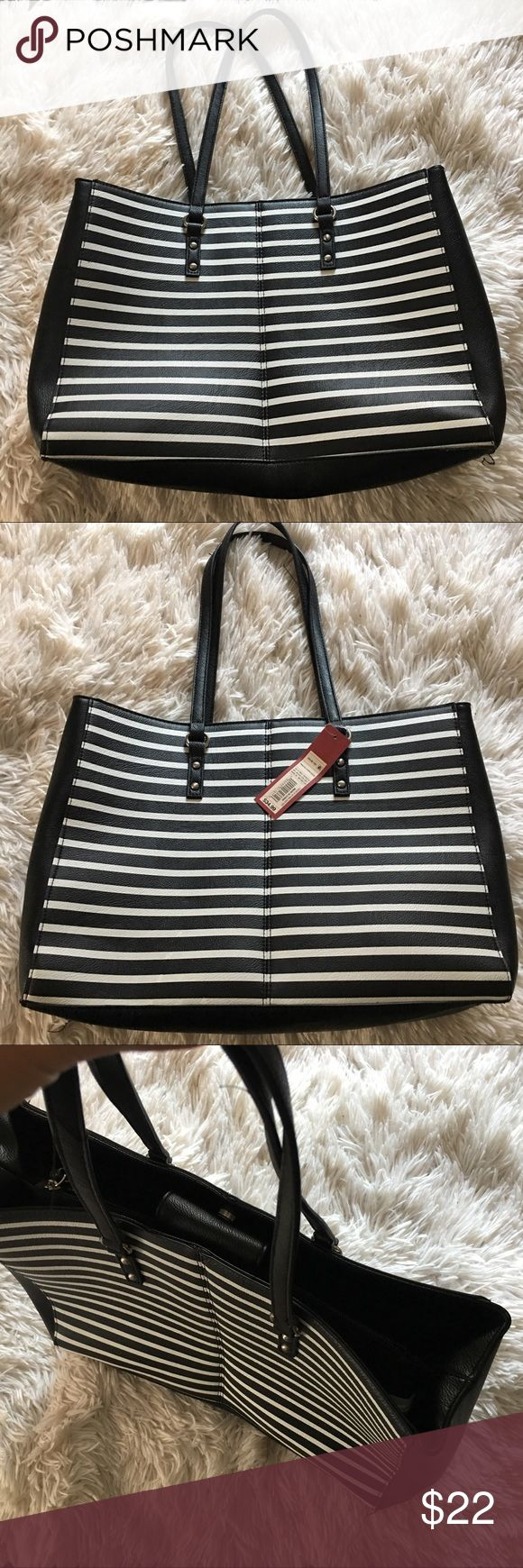 Printed Stripe Faux Leather Shoulder Bag Merona Faux Leather Printed Striped Shoulder Bag with three different compartments inside and two zipper closure pockets. Very spacious Bag useful for the organized! Has silver accents on the straps. No Trades! Speedy shipping! Happy Poshinggg🌸🌸🌸🌸 Merona Bags Shoulder Bags