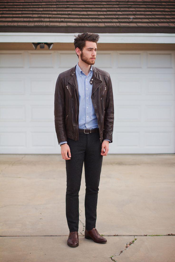 brown leather jacket, blue shirt, grey pants