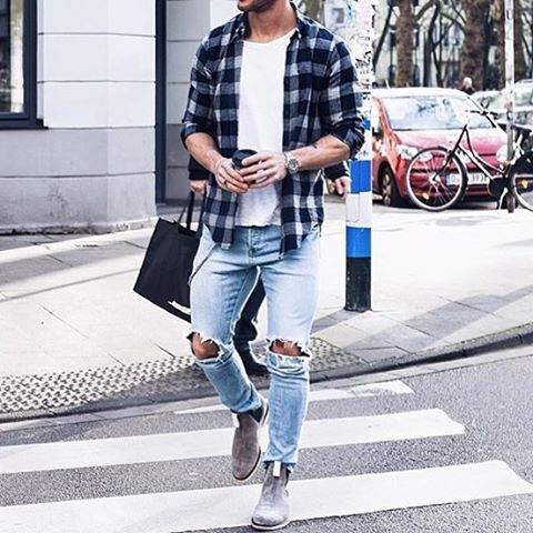 To create an outfit for lunch with friends at the weekend marry a navy blue gingham long sleeve shirt with light blue distressed skinny jeans. Elevate this ensemble with grey suede chelsea boots. Shop this look on Lookastic: https://lookastic.com/men/looks/long-sleeve-shirt-crew-neck-t-shirt-skinny-jeans/18385 — White Crew-neck T-shirt — Navy Gingham Long Sleeve Shirt — Silver Watch — Light Blue Ripped Skinny Jeans — Grey Suede Chelsea Boots