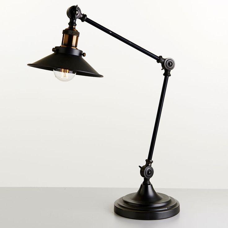 Athen Bordlampe - Athen er en elegant bordlampe i antikk stil fra MS Belysning. Lampen kommer i sort utførelse med detalj i mørk messing. Athen har tre justerbare ledd som gir den stor fleksibilitet.