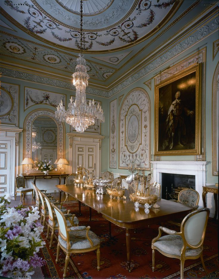 This image is an example of the Rococo period. The walls are panelled and pale in colour, gilded heavily. The carvings are quite delicate. Fauteuil chairs and mirrors can be seen, which were popular of the time.