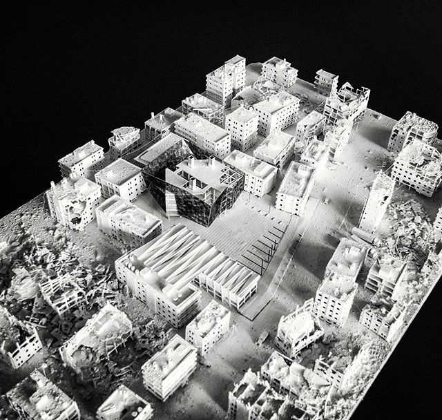 Model from above, borrowed Gerry Judah's technique for the context on this model, needed the texture. Wanted to do a model that combines his style with a standard architectural model. Model shows my intervention. Within the ruins of Gaza, a municipal centre and community incubator.  - Andreas Christodoulou Portfolio Website