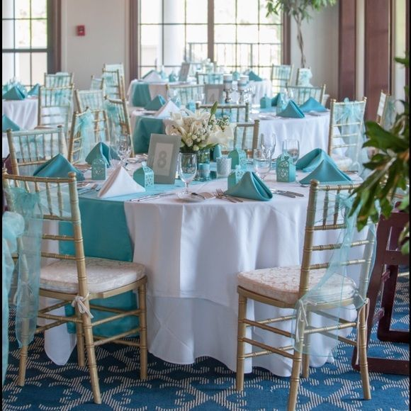 "Gorgeous Tiffany Blue & Silver wedding decorations I'm selling most of my decorations from my Tiffany Blue & silver wedding. If interested please comment.   I have:  votives Card box Pen Flower girl baskets Ring bearer pillow ""I DO"" letters Cylinder vases - SOLD LED lights - SOLD Cake stand - SOLD  Picture Frames Place card holders  Candles, Candle holders, candlesticks, Glass gem vase fillers Linens, napkins, chair covers, chair bows, table runners-SOLD Other"