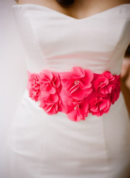 a hot pink sash on my wedding dress?!  That is definitely something I would consider...