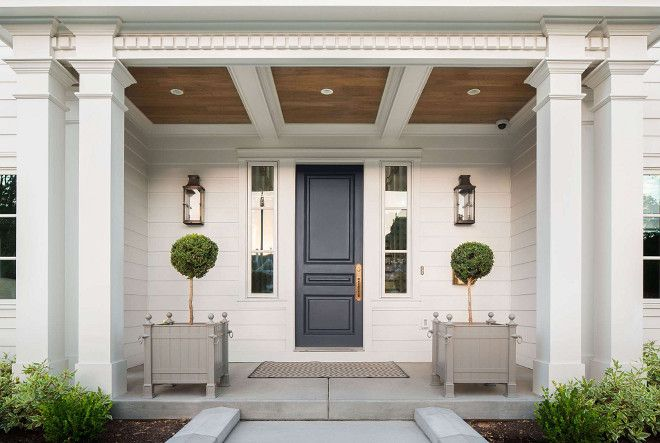 This has exactly all the details on a home exterior that I have been looking for: Double posts with molding trim & proportions, blue door/brass Baldwin entry hardware, Dentil Molding trim, woodtone porch ceiling, symmetrical planters. Just need to see the Chinese Chippendale railings!