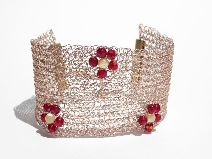 cuff bracelet crocheted in non tarnish rose gold wire with red crystal and pearl beads.