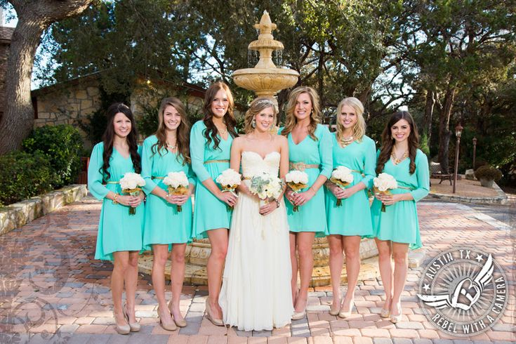 Mint green bridesmaids dresses. maybe a little longer cause I like bridesmaids dresses to be long:)