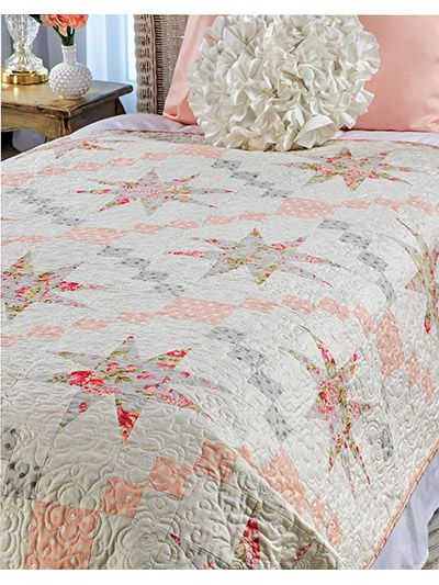 "A classic traditional quilt in soft and romantic fabrics! The soft and romantic quilt brings to mind an era when opulence was an everyday occurrence and the start of shabby chic was born. This e-pattern was originally published in the summer 2015 issue of Quilter's World magazine. Finished size is 55 1/2"" x 79 1/2"""