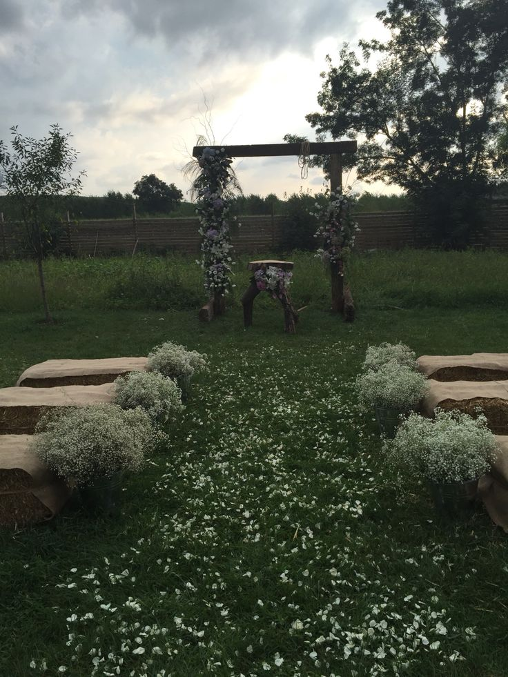 Ceremony area and the flowered backdrop of Gaye&Toygun's  country themed wedding.White rose leaves on the aisle..