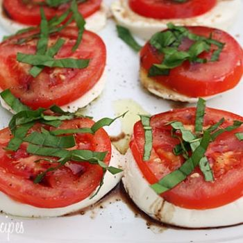 Caprese Salad-farmers market tomatoes a must but one of my must tries on hot summer night.  Insalata Caprese is a simple salad of fresh mozzarella and tomatoes topped with basil and a splash of balsamic. A perfect summer appetizer or first course, especially when tomatoes are at their peak.