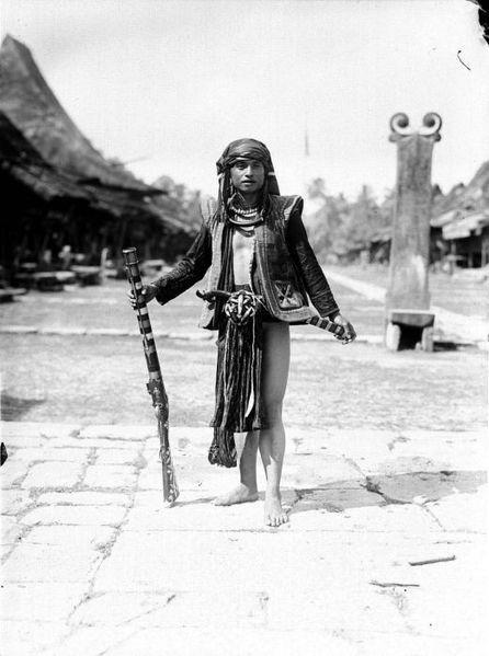 Indonesia, Nias warior ~ Nīas (Indonesian: Pulau Nias, Nias language: Tanö Niha) is an island off the western coast of Sumatra, Indonesia. Nias (Kepulauan Nias) is also the name of the archipelago, including the small Hinako Islands.