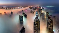 """Cryogenic City - The fog season is back in Dubai. Shot from the 73th floor rooftop of Cayan Tower in Dubai Marina. This is where my buddy Dany Eid and I are conducting a series of rooftopping workshops in December and January.   Please check my website for the first ever Rooftopping & Digital Blending workshop in Dubai coming in December!  <a href=""""http://www.danielcheongphotography.com/Website-Assets/Dubai-Workshops/n-qKHcB"""">Dubai Rooftopping Workshop</a>  Follow me on <a href=""""http://w..."""