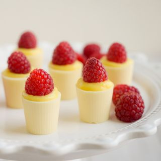 These creamy white chocolate dessert cups are waiting to be filled with your imagination. Try filling the little cordial cups with pudding or cream and fruit, or simply fill them with a favorite liquo