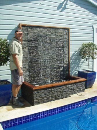 Google Image Result for http://lennoxlandscaping.com/wp-content/uploads/2010/06/Water-feature-Design-Plumming-elec-Stacker-stone-and-wood-feature-resize.jpg