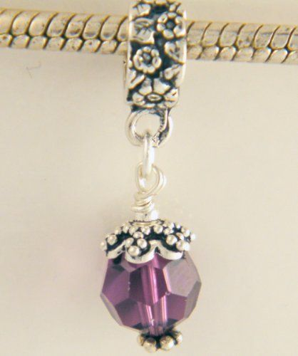 February Birthstone Amethyst Swarovski Sterling Silver Dangle Charm by CharmS cool. $20.99. Here is an absolutely gorgeous Sterling Silver dangle bead featuring a Bali and Amethyst (February Birthstone) Swarovski crystal. Item slides on. Although not authentic Pandora or Brighton, this will fit on most add a bead/charm bracelets.. Save 25%!
