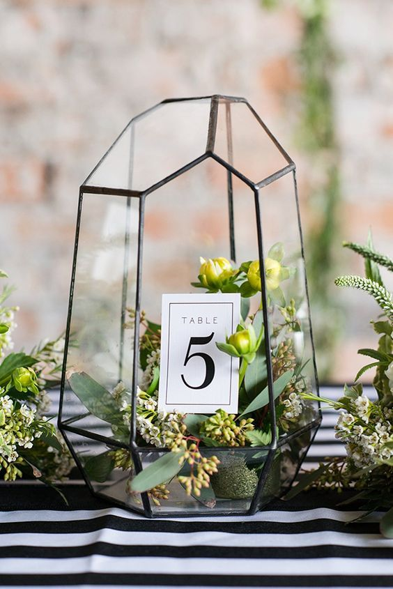 terrariums are hot for wedding decor, you may use them as centerpieces and add table numbers