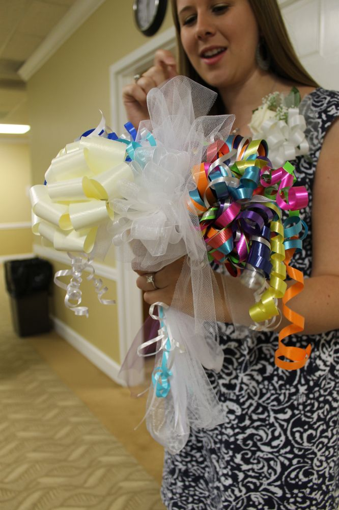 Cheap DIY wedding rehearsal dinner bouquet from recycled bridal shower bows on gifts. #wedding bouquets #cheap diy wedding bouquet