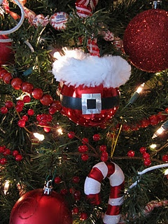 Santa ornament tutorial. Ball ornament decorated with electrical tape and foil duct work tape and giant chenille pipe cleaner.