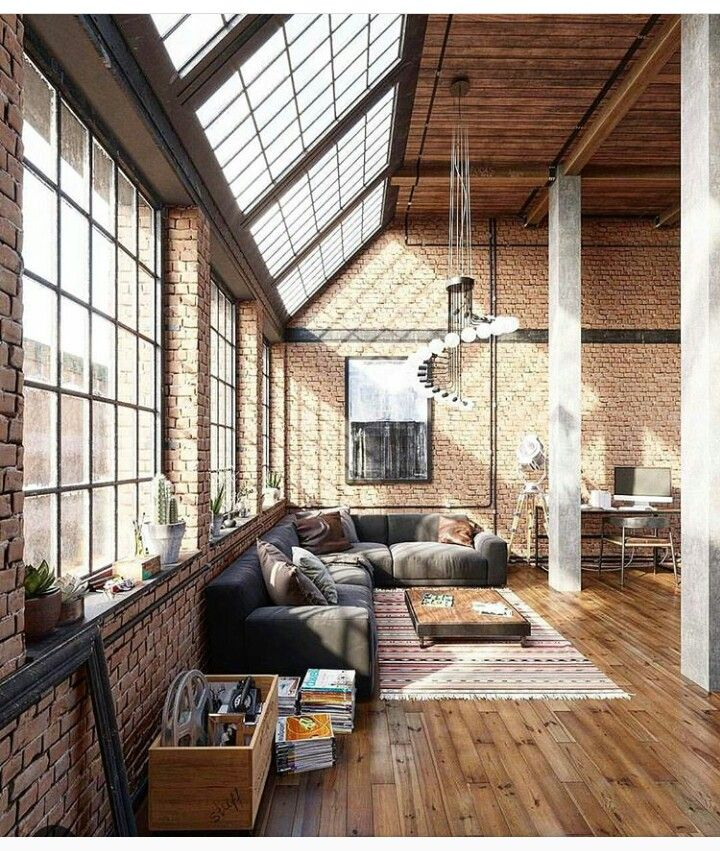 I love the huge windows, columns, and brick. Rugs are a must.
