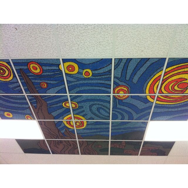 Mural done by my middle school art students. A solution to get rid of those ugly tiles in my room.