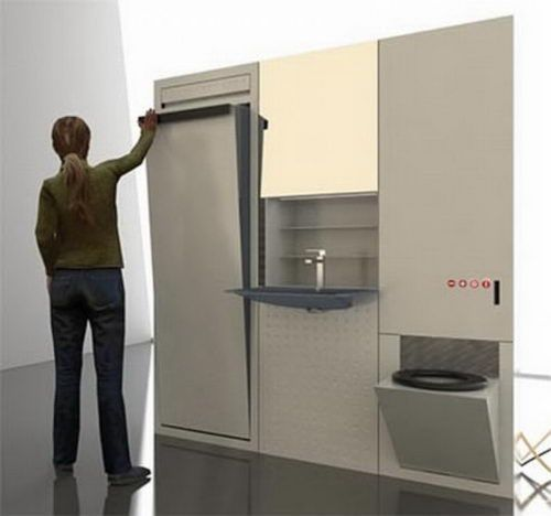 Check out this great compact bathroom design with foldaway bath/shower