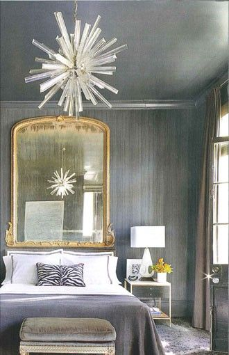 mixed metals. Sleek, dark gray bedroom with gold accents in art deco style (AD)