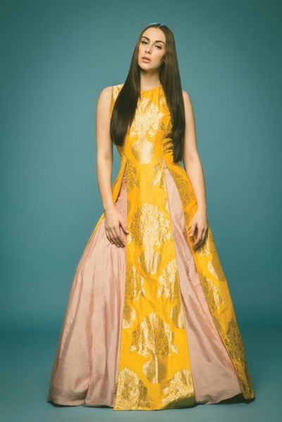 floor length gown, layered jacket silhouette, multiple slits, yellow and salmon pink, yellow and blush pink, banarsi fabric, brocade fabric, sleeveless, floor length, slit jacket with skirt, roka outfit, welcome dinner outfit, friend of the bride outfit