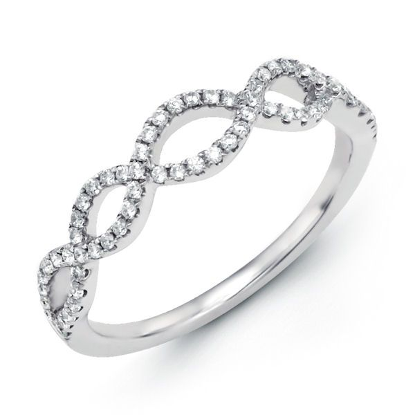 Platinum, diamond anniversary and infinity style ring. There are a total of about 66 round diamonds set in the ring. The diamonds are about 0.24 ct tw, VS1-2 in clarity and G-H in color.
