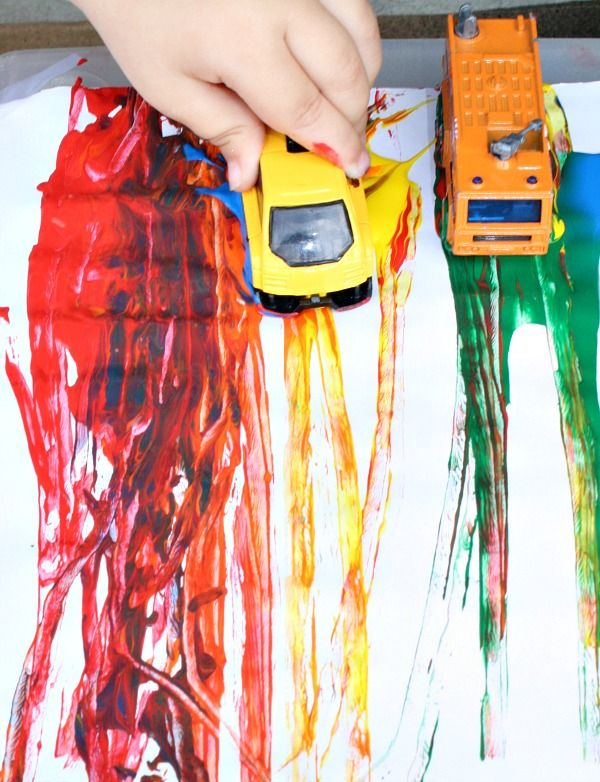Racing Rainbow Painting with Cars; explore ramps, gravity, color matching, counting and more in this fun process art activity for kids.