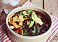 BLACK BEAN TORTILLA SOUP  Needed: 3-4 tablespoons olive oil, 1/3 yellow onion, 1 red bell pepper, 2 chipotle peppers in adobo sauce, 1/4 teaspoon cumin, salt + pepper, 1 1/2 cups veggie stock, 1 can black beans, homemade tortilla strips, avocado and cilantro to serve.