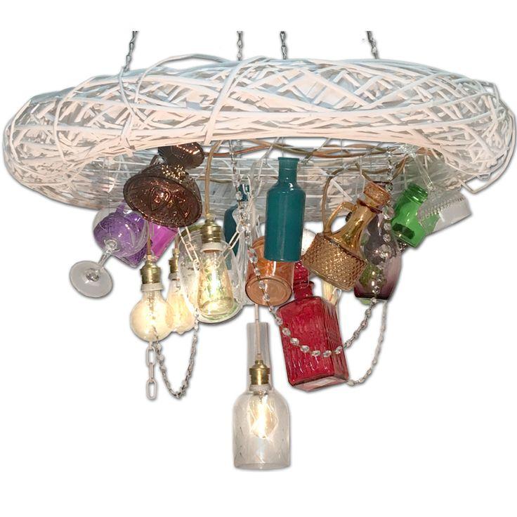 Ένα άκρως μαγικό φωτιστικό.. Το χειροποίητο κρεμαστό φωτιστικό που θυμίζει κάτι από παραμυθένιο θησαυρό. Στολισμένο ασύμετρα με διάφορα χρωματιστά vintage αντικείμενα, όπως σκαλιστά ποτήρια, παλιές αλυσίδες, μπουκάλια, καράφες κτλ.  6x E27(Edison, Led, Fyllament, Eco)