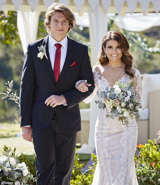Vision in white! Leah is walked down the aisle by her on-screen son VJ, played by Matt Li...
