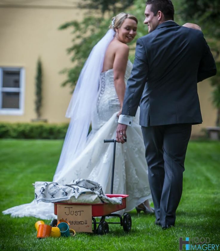 The Bride and Groom Exit! 'Just Married' cart is missing their baby after he wanted to be carried! Cart by Rhapsody Weddings http://www.rhapsodyweddings.blog.com