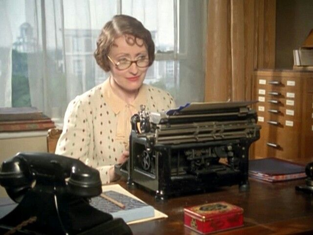 Miss Lemon with her typwriter.  Agatha Christies Poirot