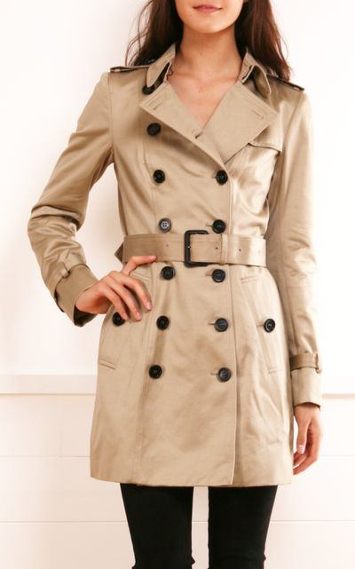 Burberry Prorsum khaki trench coat- Shower-proof trench coat with a belt at waist and straps at epaulets and cuffs. Burberry Prorsum coat has a a hook-fastening collar, long sleeves, button-fastening side slit pockets, storm flaps, a buttoned wind flap, a vent at back, designer-stamped black button fastenings through double-breasted front and is fully lined. A classic that will never go out of style.