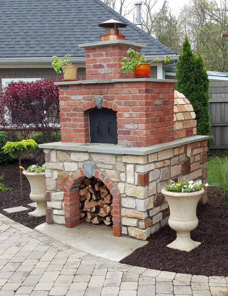 One of the most spectacular Wood-Fired Outdoor Brick Pizza Ovens of 2015. A great mix of Red Brick with Tan Brick and Natural Stone to create a beautiful, yet rustic brick oven.  BrickWoodOvens.com