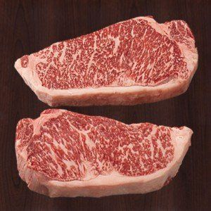 """American Kobe Beef. Not so fast. There's no such thing. Actual Kobe beef comes from Japan. What you get here in the U.S. is American Wagyu  beef (a hybrid of the Japanese Wagyu and the Angus cattle). Still, the tell-tale sign of this """"Kobe"""" like beef is the extensive marbling of fat, which gives the meat its flavor and tenderness. Expensive? Yes. But every now and then, a small filet is worth it."""