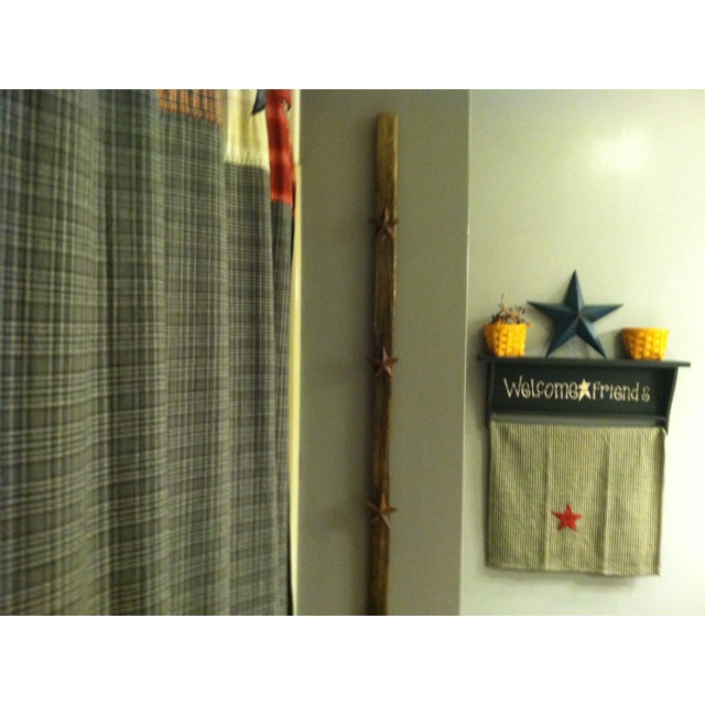 Tobacco stick with star pins. Used as a towel rack.