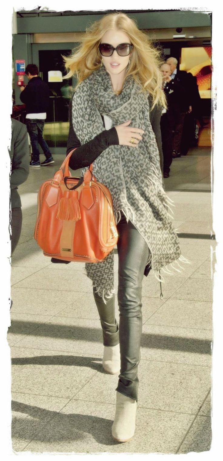 Rosie #Huntington Whiteley Street Style Snapshot - Rosie Huntington-Whiteley was caught arriving at Heathrow Airport in London, England. She wore her Burberry Leather ankle-zip leggings with some Rag & Bone Newbury boots and a Burberry bag. Rosie just looks amazing here. I just love seeing her wear her leather pants. She has one of the best pairs of legs to wear them.