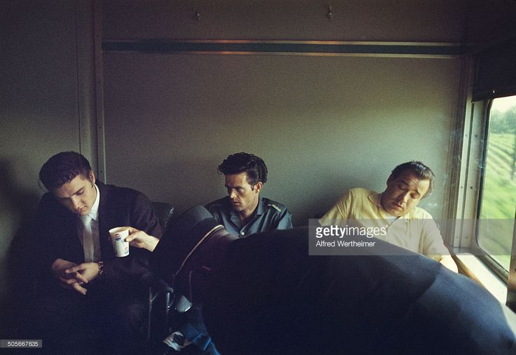 Alfred Wertheimer/Getty Images) On the New York to Memphis train, Junior Smith (center) offer his cousin, American musician (and actor) Elvis Presley (1935 - 1977), a drink, July 3 or 4, 1956. Elvis had been in a New York for appearance on the 'Steve Allen Show' and to record the songs 'Hound Dog' and 'Don't Be Cruel'; he was on