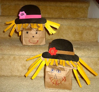 Stuffed paper bag scarecrows.