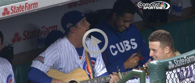 """Listen to John Baker and Anthony Rizzo try to sing Eddie Vedder's tribute to the Cubs, """"All the Way,"""" in the dugout during the four-hour rain delay."""