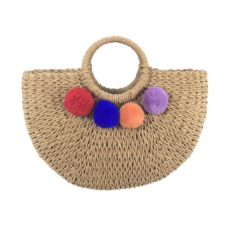 Handmade pom pom straw bag