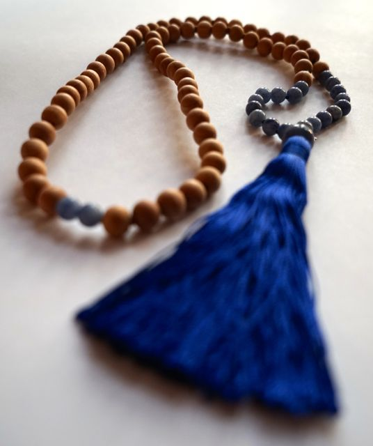 Juniper beads with lapis accents and silk tassel