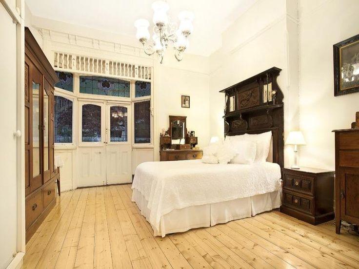 Classic bedroom design idea with floorboards & built-in wardrobe using brown colours - Bedroom photo 224549