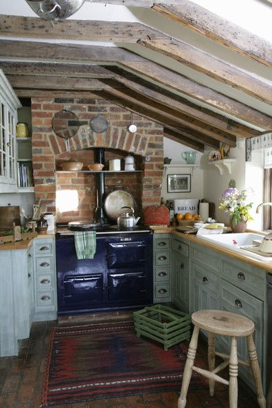 .Ohhh sooooo love this! It has every element I want in a kitchen...the ceiling, sink in from of a window, old oven, wood floors, lovely cabinet colors...etc...: