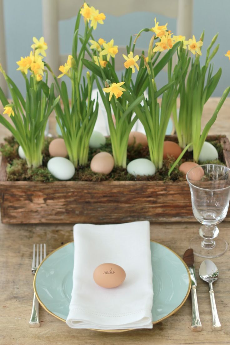 "Entertaining: Write Names on Eggs as ""place card"" for spring or easter meal. I like the center piece and the use of no colored eggs."