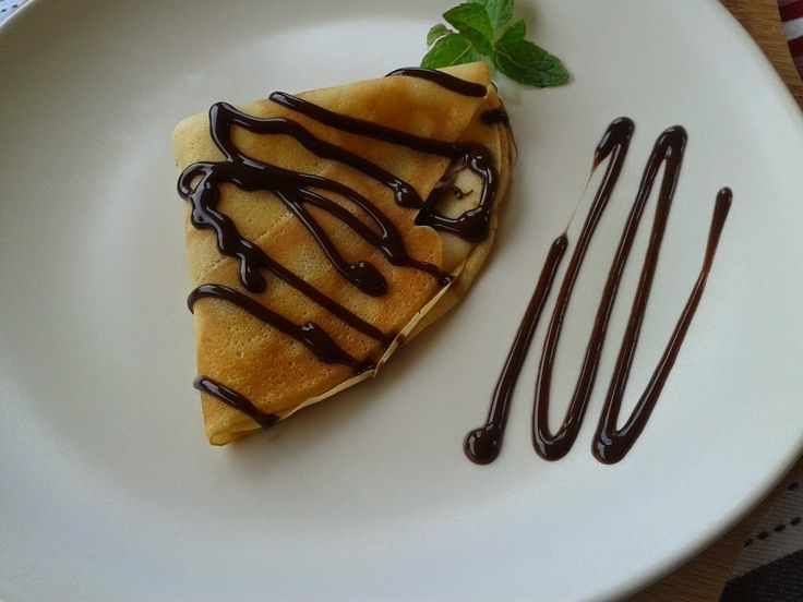 """Nutella and chocolate sauce The word Crêpehas itsorigin in France, deriving from the Latin crispa meaning """"curled"""".While crêpes are often associated wit"""